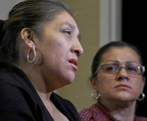 Sandra Diaz, right, listens as Victorina Morales, right, recalls her experience working at President Donald Trump's golf resort in Bedminster, N.J., during an interview, Friday Dec. 7, 2018, in New York. Both Morales and Diaz say they used false legal documents to get hired at the resort and supervisors knew it.