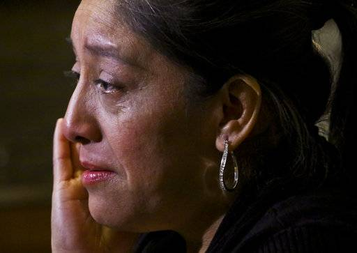 "Victorina Morales becomes tearful during an interview, as she recalls ""humiliating"" treatment at the hands of a supervisor while working at President Donald Trump's golf resort in Bedminster, N.J., Friday Dec. 7, 2018, in New York. Morales say she used false legal documents to get hired and supervisors knew it."