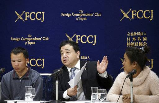 In this Nov. 28, 2018, photo, lawyer Shoichi Ibusuki, center, speaks during a press conference in Tokyo, on the problems in Japan's technical intern program, with Eng Pisey, right, Cambodian technical trainee and Huang Shihu, left, Chinese technical trainee in Tokyo. Ibusuki, lawyer specializing in labor cases and supporting victimized foreign students and interns, called the internship program as a disguise to use trainees as mere cheap labor and should be scrapped and replaced with the new program underway. Japan is set to approve legislation that would officially open the door to foreign workers to do unskilled jobs and possibly eventually become citizens. Lawmakers were due to vote Friday, Dec. 7, on a government proposal to allow hundreds of thousands of foreign laborers to live and work in a country that has long resisted accepting outsiders.