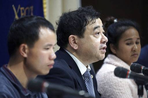 In this Nov. 28, 2018, photo, lawyer Shoichi Ibusuki, center, attends a press conference on the problems in Japan's technical intern program, with Eng Pisey, right, Cambodian technical intern and Huang Shihu, left, Chinese technical intern in Tokyo. Ibusuki, lawyer specializing in labor cases and supporting victimized foreign students and interns, called the internship program as a disguise to use trainees as mere cheap labor and should be scrapped and replaced with the new program underway. Japan is set to approve legislation that would officially open the door to foreign workers to do unskilled jobs and possibly eventually become citizens.