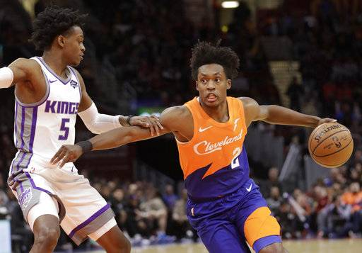 Cleveland Cavaliers' Collin Sexton (2) drives to the basket against Sacramento Kings' De'Aaron Fox (5) in the first half of an NBA basketball game, Friday, Dec. 7, 2018, in Cleveland.