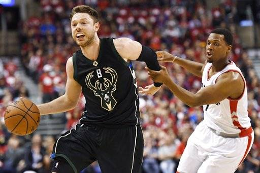 FILE - In this April 24, 2017 file photo, Milwaukee Bucks guard Matthew Dellavedova (8) drives to the net against Toronto Raptors guard Kyle Lowry (7) during the second half of game five of an NBA first-round playoff series basketball game in Toronto.  Dellavedova is coming back to the Cavaliers. He won't recognize them. Cleveland re-acquired the popular, scrappy guard on Friday in a three-team trade with the Milwaukee Bucks and Washington Wizards. (Frank Gunn/The Canadian Press via AP, File)