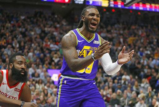 Utah Jazz forward Jae Crowder (99) reacts after being called with for foul, as Houston Rockets guard James Harden, left, watches during the first half of an NBA basketball game Thursday Dec. 6, 2018, in Salt Lake City.