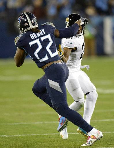 Tennessee Titans running back Derrick Henry (22) runs against Jacksonville Jaguars cornerback A.J. Bouye (21) during the first half of an NFL football game, Thursday, Dec. 6, 2018, in Nashville, Tenn. Henry scored a touchdown on the 99-yard run.