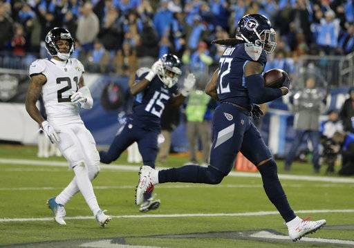 Tennessee Titans running back Derrick Henry (22) runs into the end zone for a touchdown against the Jacksonville Jaguars during the second half of an NFL football game, Thursday, Dec. 6, 2018, in Nashville, Tenn.