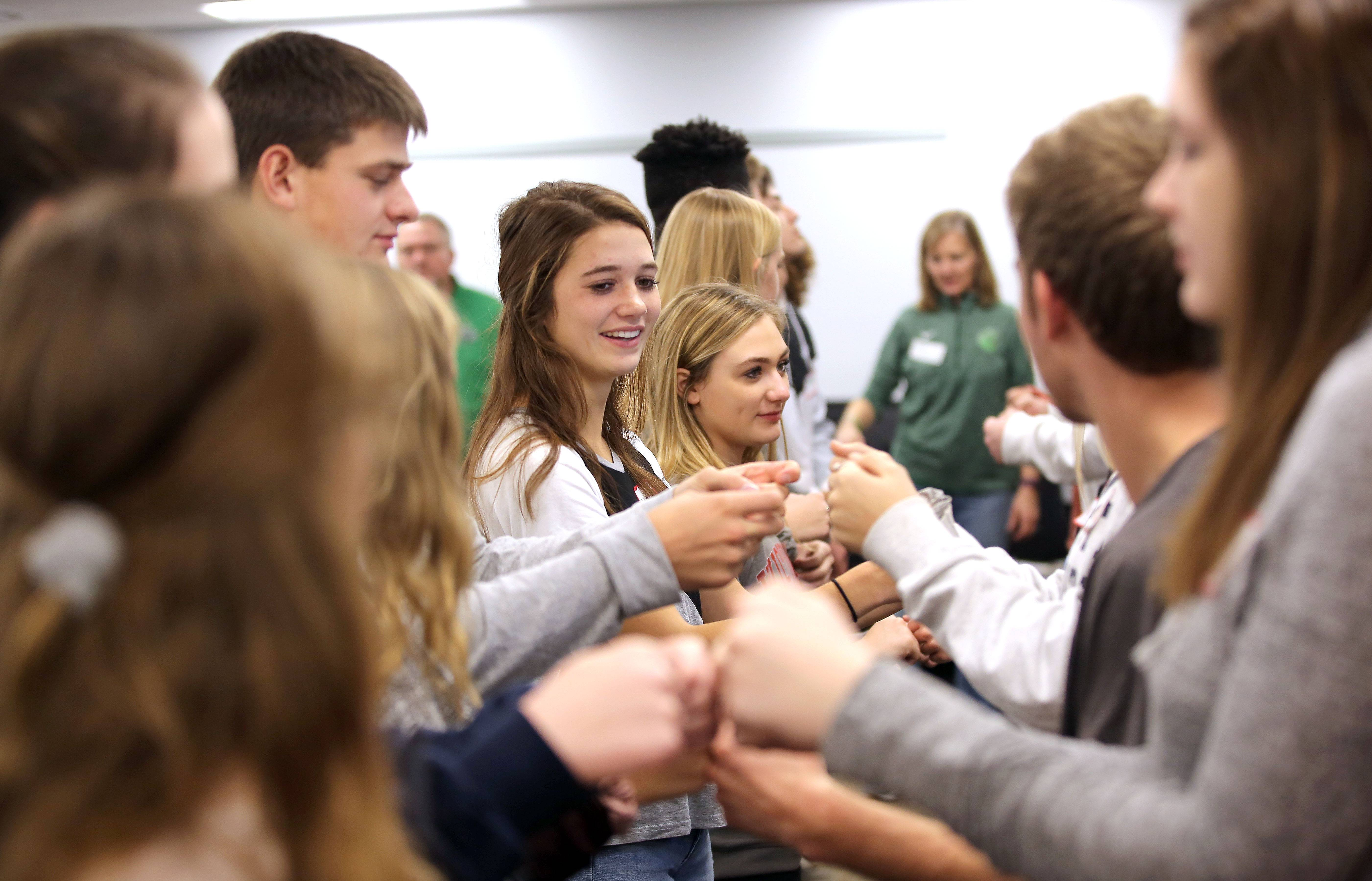 "Libertyville High School students considered ""influencers"" in their social circles participate in the Green Dot program aimed at empowering members of the school community to intervene in cases of bullying and other abuse."