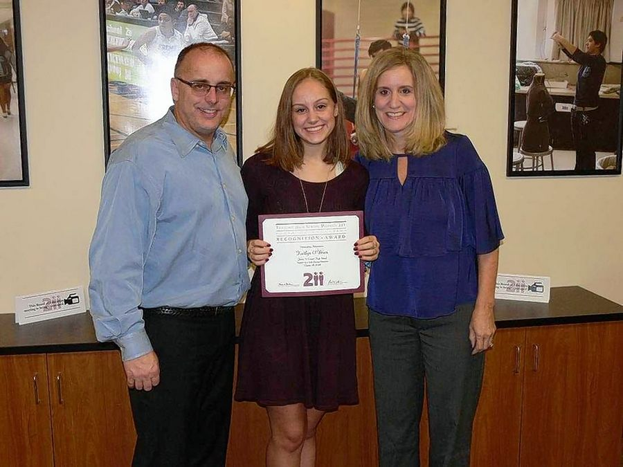 Conant High School senior Kaitlyn O'Brien, with parents Catherine and Robert O'Brien, was recognized by the Palatine-Schaumburg Township High School District 211 school board with a lifesaver award. O'Brien used the CPR skills she learned at school to help save the life of a woman who suffered a cardiac arrest.