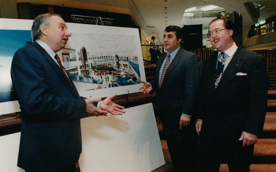 Schaumburg Mayor Al Larson looks over an artist's rendering of Woodfield Mall's expansion plans with John Simon, senior vice president, and mall general manager Jim Linowski.