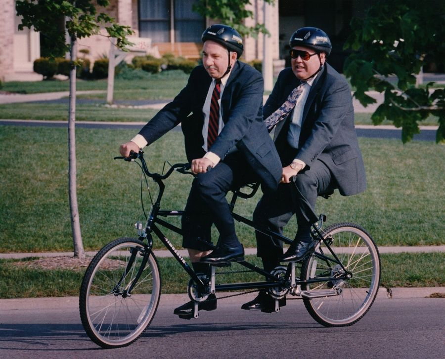 "Schaumburg Mayor Al Larson and then-Village Manager George Longmeyer take a village bike path on ""Bike to Work Day"" in 1992."