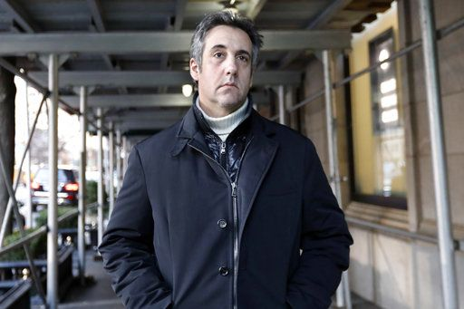 Michael Cohen, former lawyer to President Donald Trump, leaves his apartment building on New York's Park Avenue, Friday, Dec. 7, 2018. In the latest filings Friday, prosecutors will weigh in on whether Cohen deserves prison time and, if so, how much.