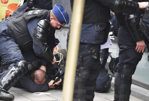 Police detain protestors in the European Quarter during a demonstration in Brussels, Saturday, Dec. 8, 2018. Hundreds of police officers are being mobilized in Brussels Saturday, where yellow vest protesters last week clashed with police and torched two police vehicles. More than 70 people were detained.