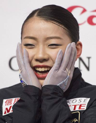 Rika Kihira, of Japan, reacts after hearing her scores for the women's free skate at figure skating's Grand Prix Final in Vancouver, British Columbia, Saturday, Dec. 8, 2018. (Jonathan Hayward/The Canadian Press via AP)