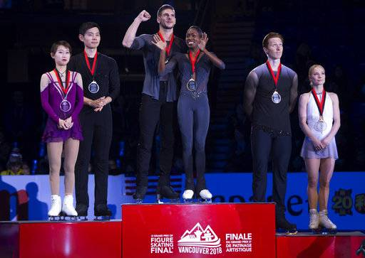 Gold medalists Vanessa James and Morgan Cipres, center, of France, stand on the podium with silver medalists Cheng Peng and Yang Jin, left, of China, and bronze medalists Evgenia Tarasova and Vladimir Morozov, of Russia, following the pairs free skate at figure skating's Grand Prix Final in Vancouver, British Columbia, Saturday, Dec. 8, 2018. (Jonathan Hayward/The Canadian Press via AP)
