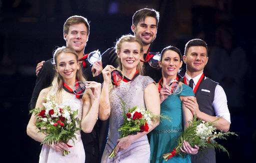Gold medalists Madison Hubbell and Zachary Donohue, center, of the United States, celebrate their win, next to silver medalists Victoria Sinitsina and Nikita Katsalapov, left, of Russia, and bronze medalists Charlene Guignard and Marco Fabbri, of Italy, following the ice dance free dance at figure skating's Grand Prix Final in Vancouver, British Columbia, Saturday, Dec. 8, 2018. (Jonathan Hayward/The Canadian Press via AP)