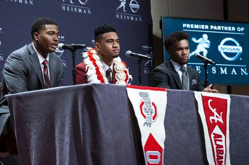 Heisman Trophy finalists, from left, Dwayne Haskins, from Ohio State; Tua Tagovailoa, from Alabama; and Kyler Murray, from Oklahoma, answer questions during a media event Saturday, Dec. 8, 2018, in New York.