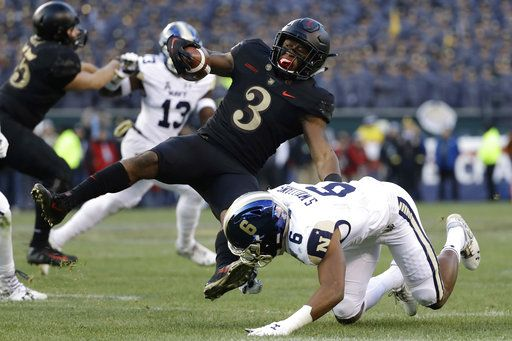 Army's Jordan Asberry, left, is tackled by Navy's Sean Williams during the first half of an NCAA college football game, Saturday, Dec. 8, 2018, in Philadelphia.