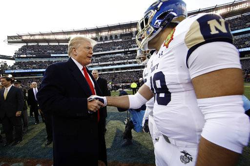President Donald Trump meets with Navy player Anthony Gargiulo ahead of an NCAA college football game between Army and Navy, Saturday, Dec. 8, 2018, in Philadelphia.