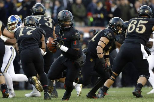 Army's Kelvin Hopkins Jr. drops back during the first half of an NCAA college football game against Navy, Saturday, Dec. 8, 2018, in Philadelphia.