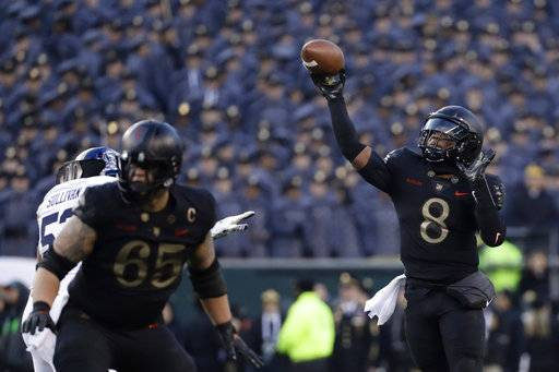 Army's Kelvin Hopkins Jr. throws a pass during the first half of an NCAA college football game against Navy, Saturday, Dec. 8, 2018, in Philadelphia.