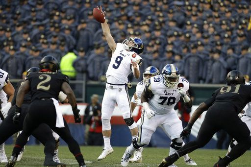 Navy's Zach Abey leaps for a high snap during the first half of an NCAA college football game against Army, Saturday, Dec. 8, 2018, in Philadelphia.