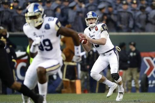 Navy's Zach Abey looks to pass during the first half of an NCAA college football game against Army, Saturday, Dec. 8, 2018, in Philadelphia.