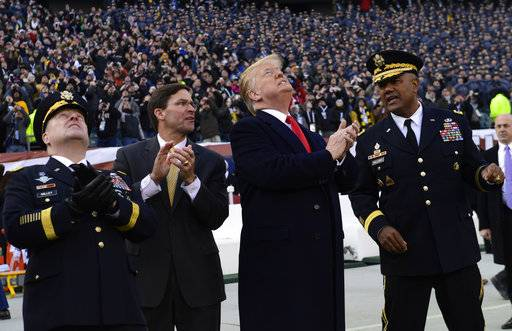 President Donald Trump, second from right, watches a flyover before the start of the Army-Navy football game in Philadelphia, Saturday, Dec. 8, 2018. Army Chief of Staff Gen. Mark Milley is at left,. and West Point Superintendent Lt. Gen. Darryl A. Williams, right.