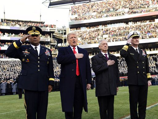 President Donald Trump, second from left, is joined by, from left, West Point Superintendent Lt. Gen. Darryl A. Williams, Defense Secretary Jim Mattis and Naval Academy Superintendent Vice Adm. Ted Carter, during the playing of the national anthem before the start of the Army-Navy NCAA college football game in Philadelphia, Saturday, Dec. 8, 2018.