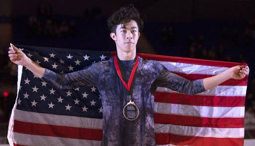 Nathan Chen, of the United States celebrates his gold medal win following the mens free skate at the figure skating's Grand Prix Final in Vancouver, Friday, Dec. 7, 2018.(Jonathan Hayward/The Canadian Press via AP)