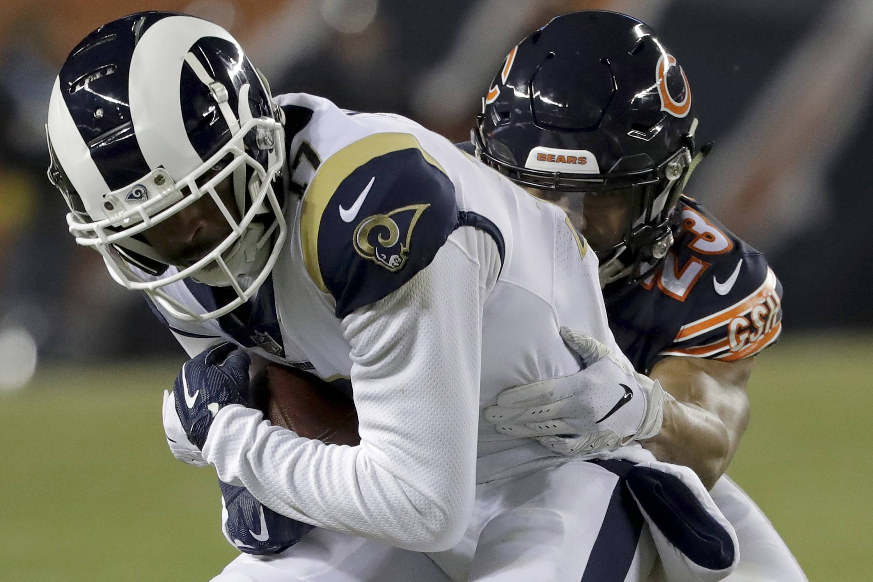 Bears cornerback Kyle Fuller (23) tackles Los Angeles Rams wide receiver Robert Woods (17) during the first half on Sunday in Chicago. Once again, the Bears' defense carried the day and stomped all over the high-flying Rams offense.