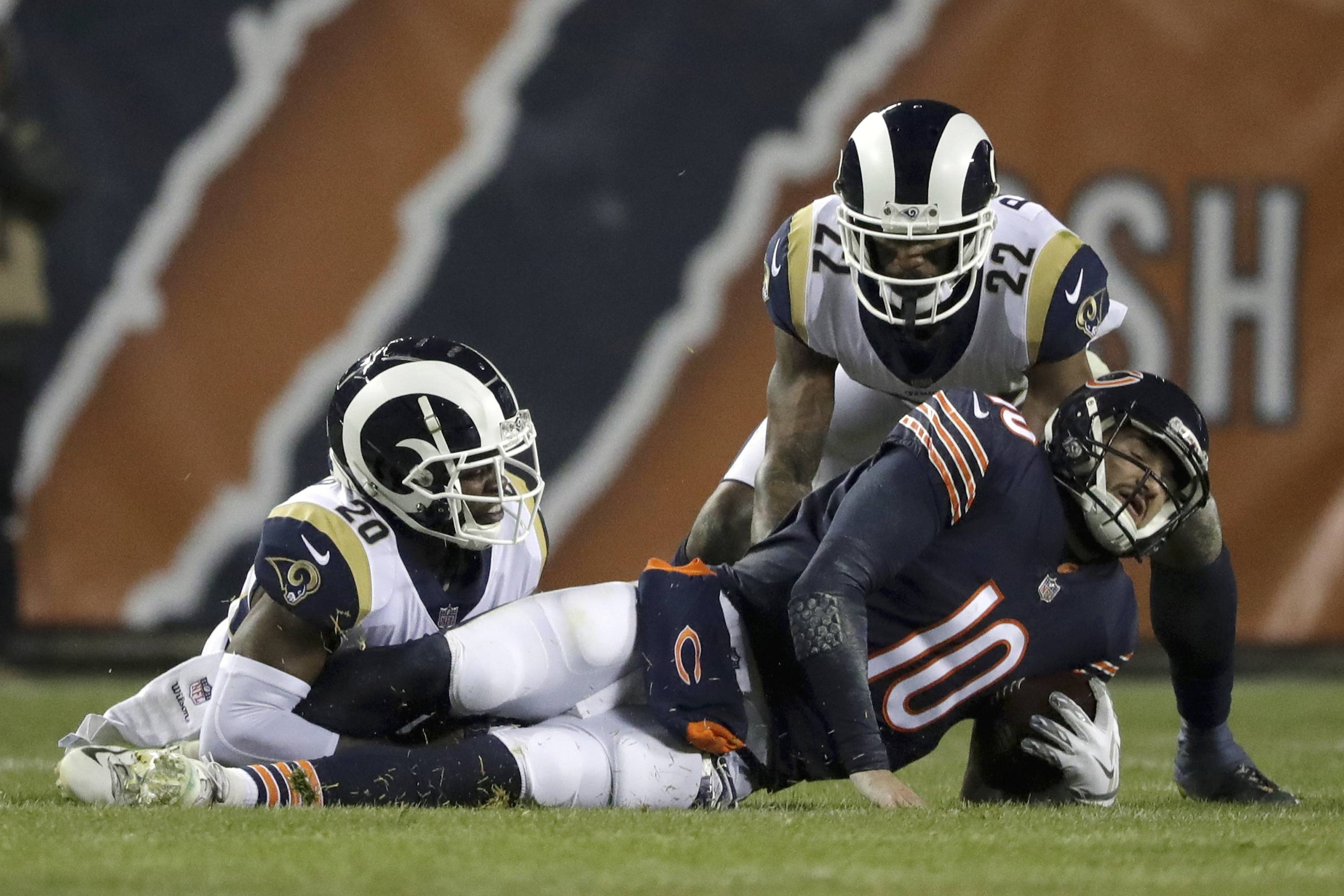 Chicago Bears quarterback Mitchell Trubisky (10) is sacked by Los Angeles Rams free safety Lamarcus Joyner (20) during the first half of an NFL football game Sunday, Dec. 9, 2018, in Chicago. (AP Photo/Nam Y. Huh)