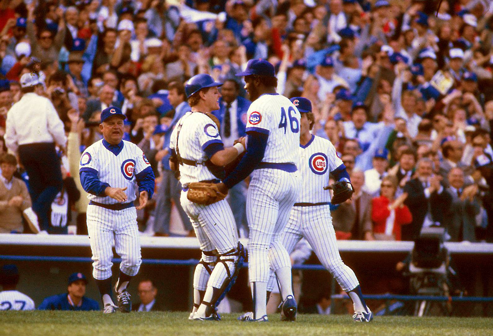 Chicago Cubs' Lee Smith is greeted by his teammates as he walks to the dugout during the October 1984 National League championship series against the San Diego Padres. Smith was elected to the Basebal Hall of Fame Sunday, and he said he'd love to go in depicted in a Chicago Cubs cap.