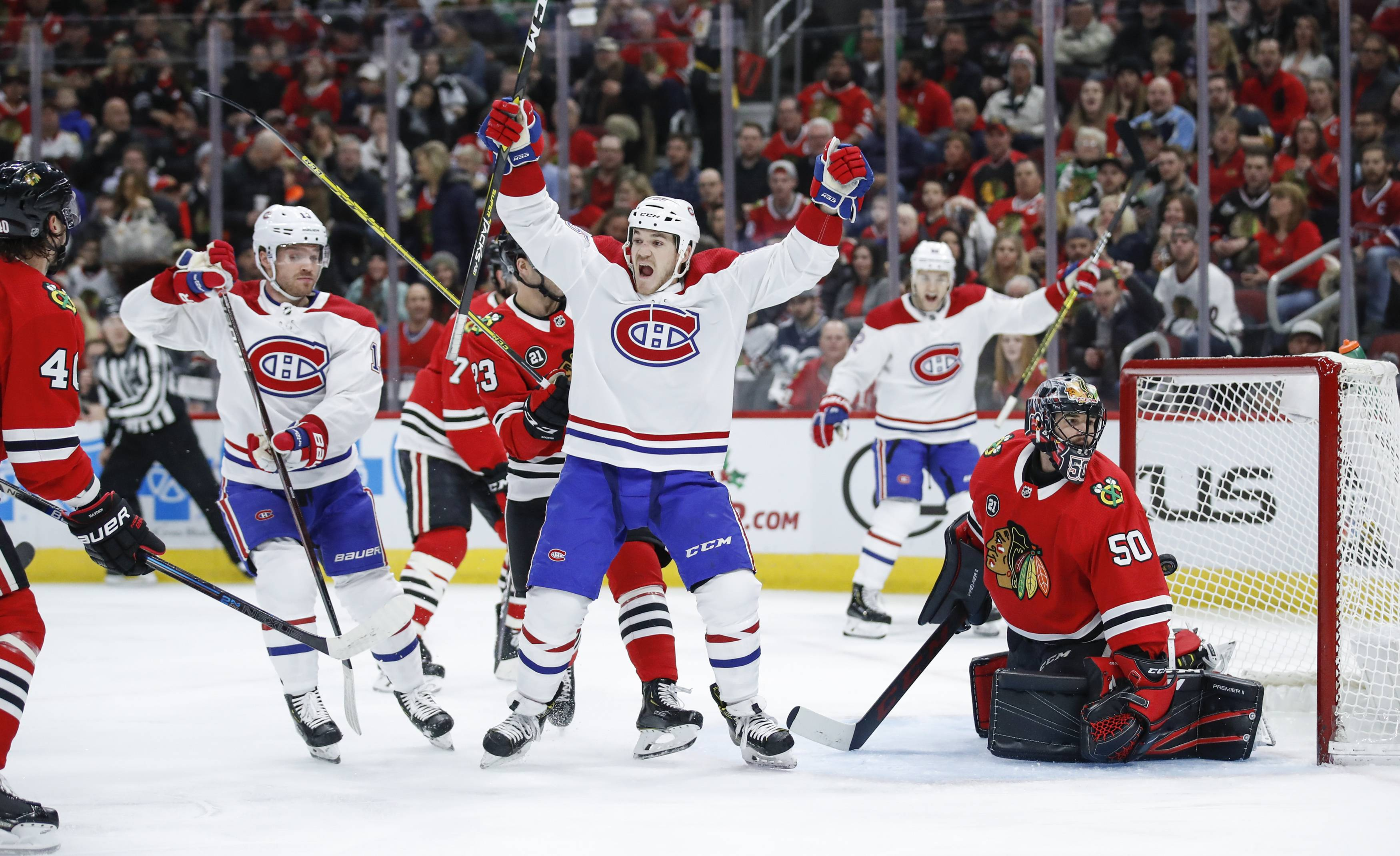 Montreal Canadiens right wing Andrew Shaw, center, reacts to a goal scored by left wing Max Domi, second left, against Blackhawks goaltender Corey Crawford, right, during the first period on Sunday in Chicago.