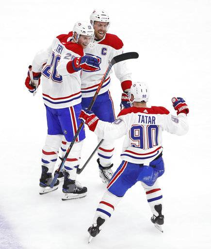 Montreal Canadiens left wing Tomas Tatar (90) celebrates with defenseman Jeff Petry (26) and defenseman Shea Weber (6) after scoring against the Chicago Blackhawks during the third period of an NHL hockey game Sunday, Dec. 9, 2018, in Chicago.