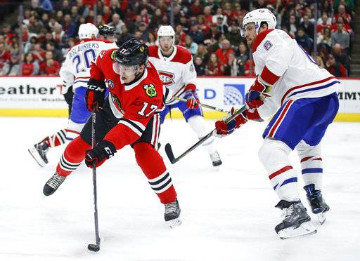 Chicago Blackhawks center Dylan Strome (17) passes the puck away from Montreal Canadiens defenseman Shea Weber (6) during the second period of an NHL hockey game Sunday, Dec. 9, 2018, in Chicago.