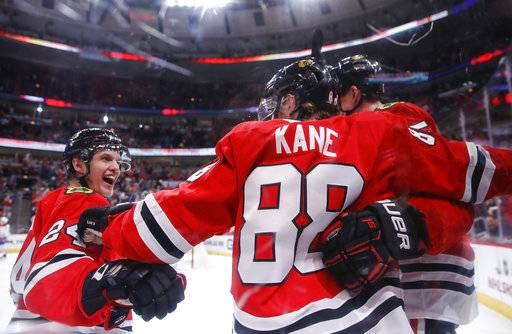 Chicago Blackhawks right wing Patrick Kane (88) celebrates with teammates after scoring against the Montreal Canadiens during the second period of an NHL hockey game Sunday, Dec. 9, 2018, in Chicago.
