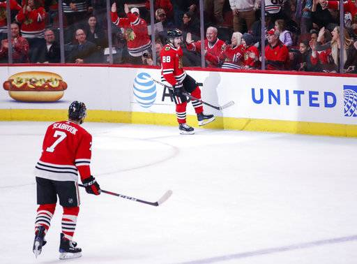 Chicago Blackhawks right wing Patrick Kane (88) reacts after scoring against the Montreal Canadiens during the first period of an NHL hockey game Sunday, Dec. 9, 2018, in Chicago.