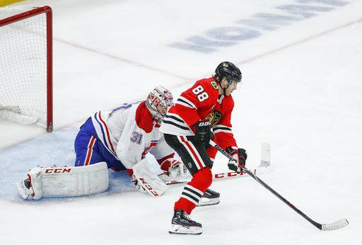 Chicago Blackhawks right wing Patrick Kane (88) looks to score against Montreal Canadiens goaltender Carey Price (31) during the third period of an NHL hockey game Sunday, Dec. 9, 2018, in Chicago.