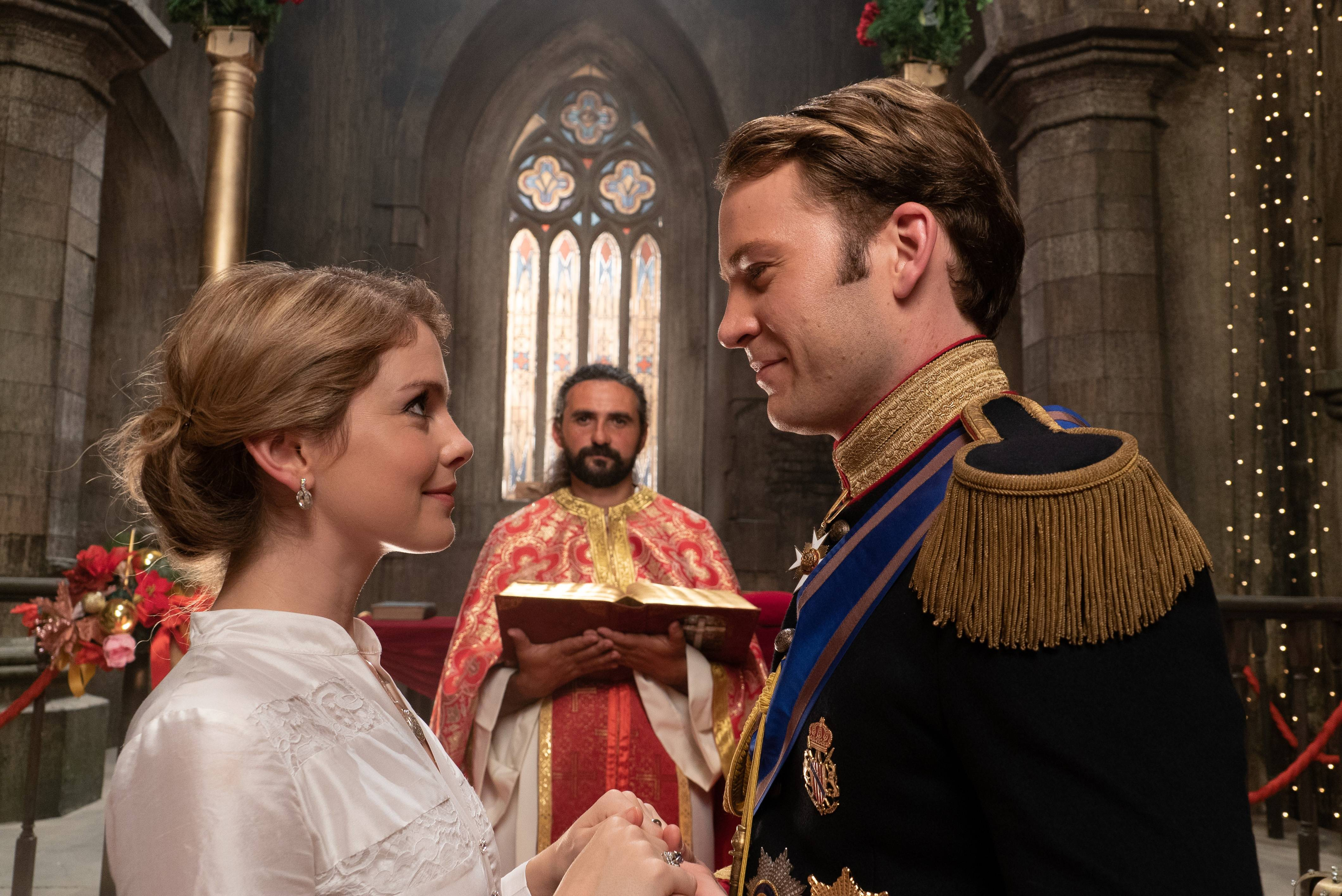 "Amber (Rose McIver) and Richard (Ben Lamb) prepare to marry in Netflix's ""A Christmas Prince: A Royal Wedding."""