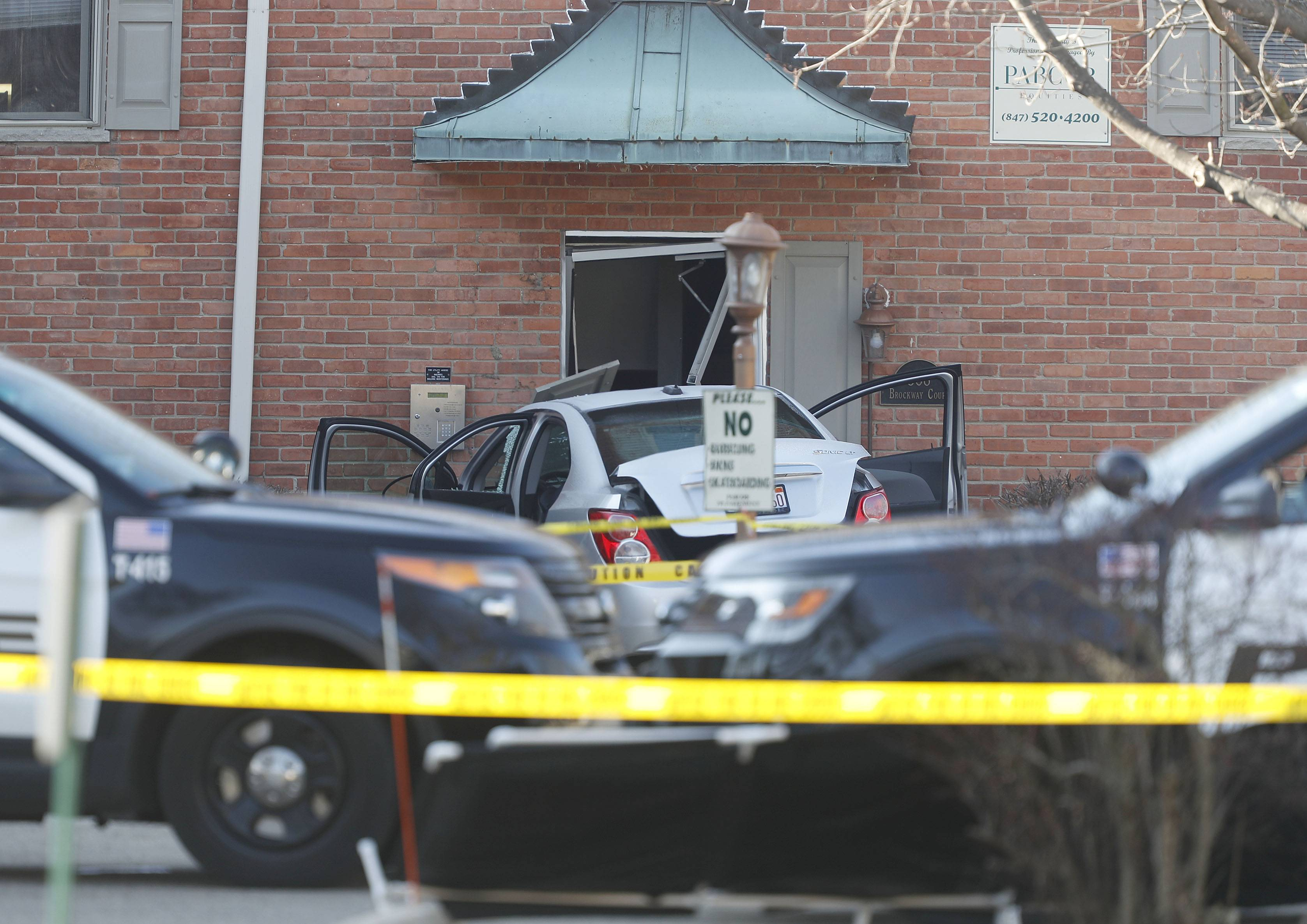 Authorities on Monday identified a 51-year-old Palatine man as the person shot and killed when he drove the silver car in the background into a police officer responding to reports of a murder early Sunday. The man's 74-year-old mother later was found dead in his apartment, authorities said.