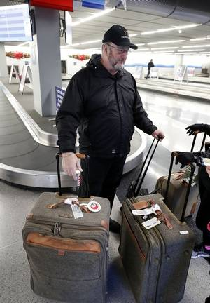 Roger Cannon of Palatine admits he has had few problems with bags during his years of travel at O'Hare International Airport. A new federal rule offers consumers more information about mishandled luggage and damaged wheelchairs.