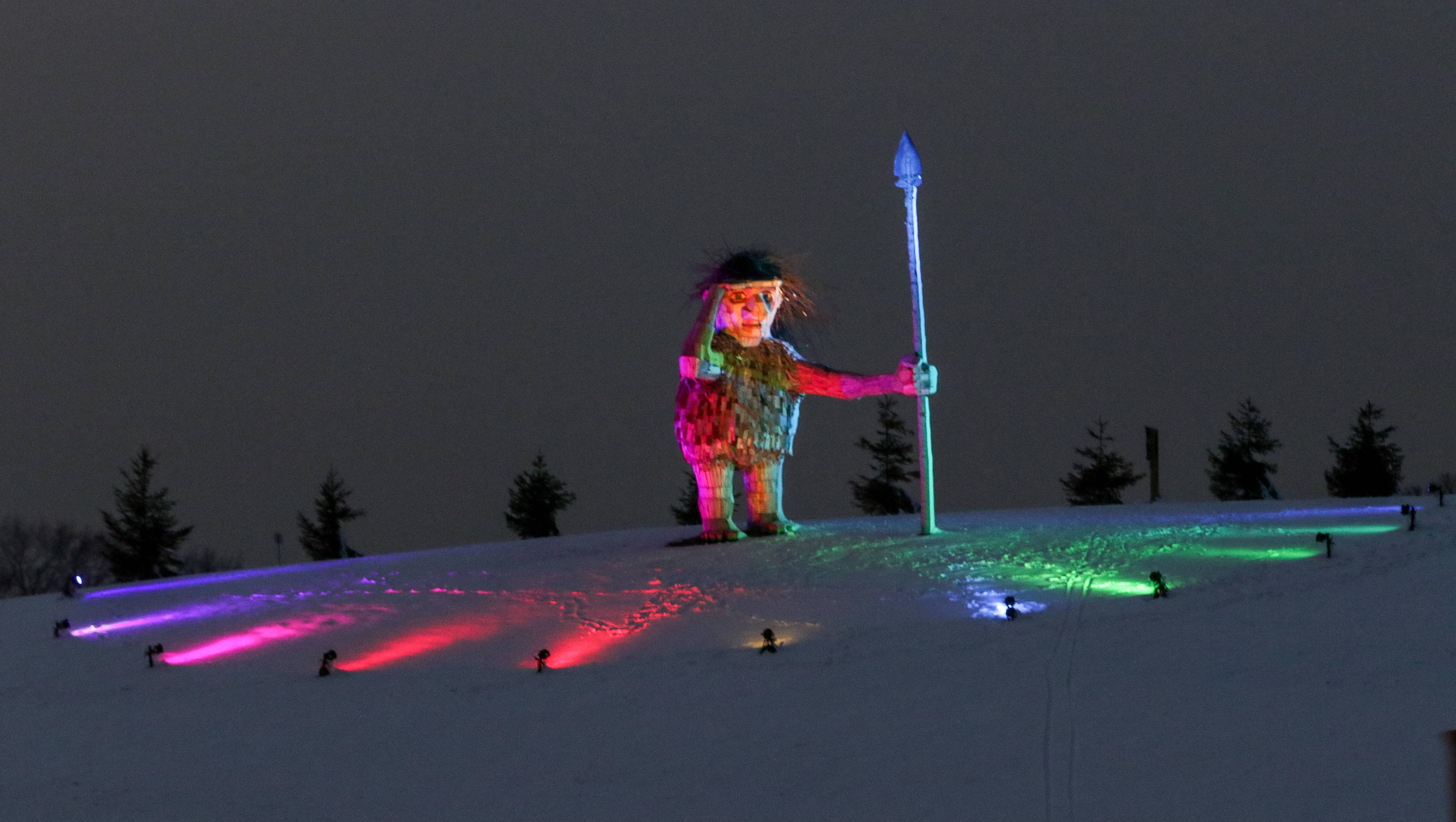 Joe the Guardian, the troll overlooking I-88 in Lisle, is lit up with colorful lights, part of the Illumination at the Morton Arboretum.