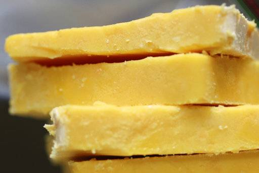 The practice of adding color to cheddar cheese reaches back to when cheesemakers in England skimmed the butterfat from milk to make butter, according to Elizabeth Chubbuck of Murray's Cheese in New York.