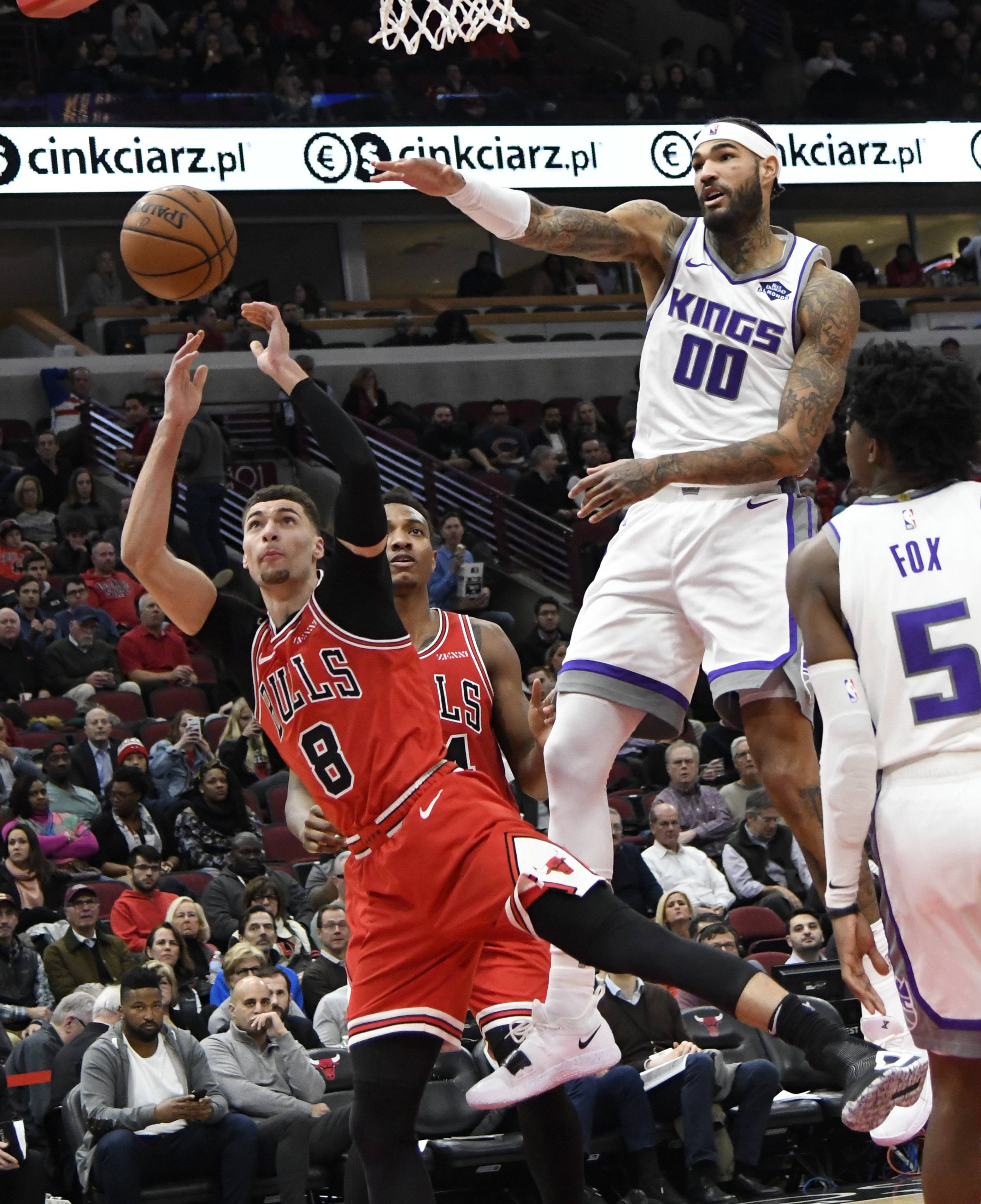 Bulls guard Zach LaVine (8) is defended by Sacramento Kings center Willie Cauley-Stein (00) during the second half Monday at the United Center. LaVine led the Bulls with 19 points.