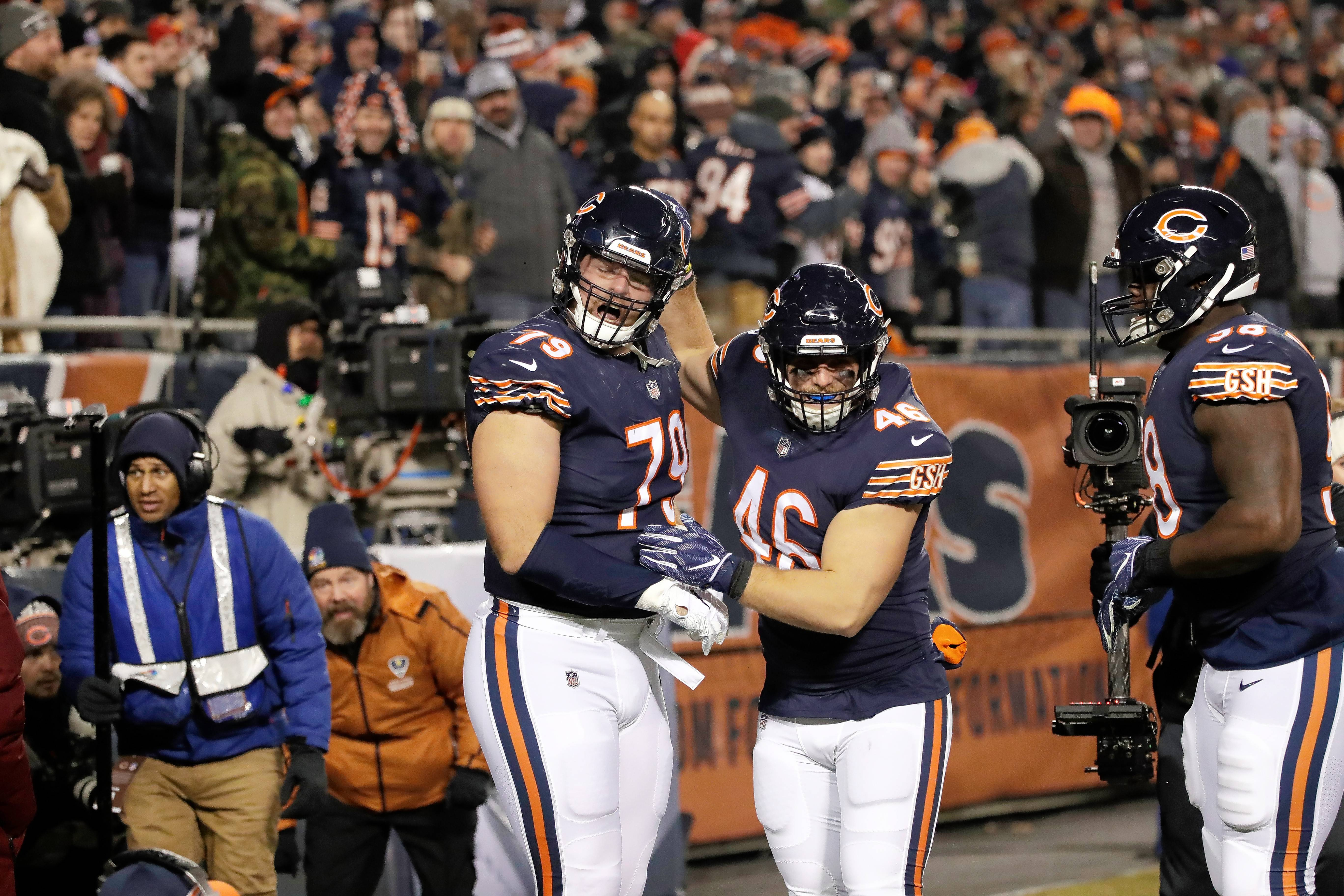 Chicago Bears offensive tackle Bradley Sowell (79) celebrates a touchdown with fullback Michael Burton (46) during the second half of an NFL football game against the Los Angeles Rams Sunday, Dec. 9, 2018, in Chicago.