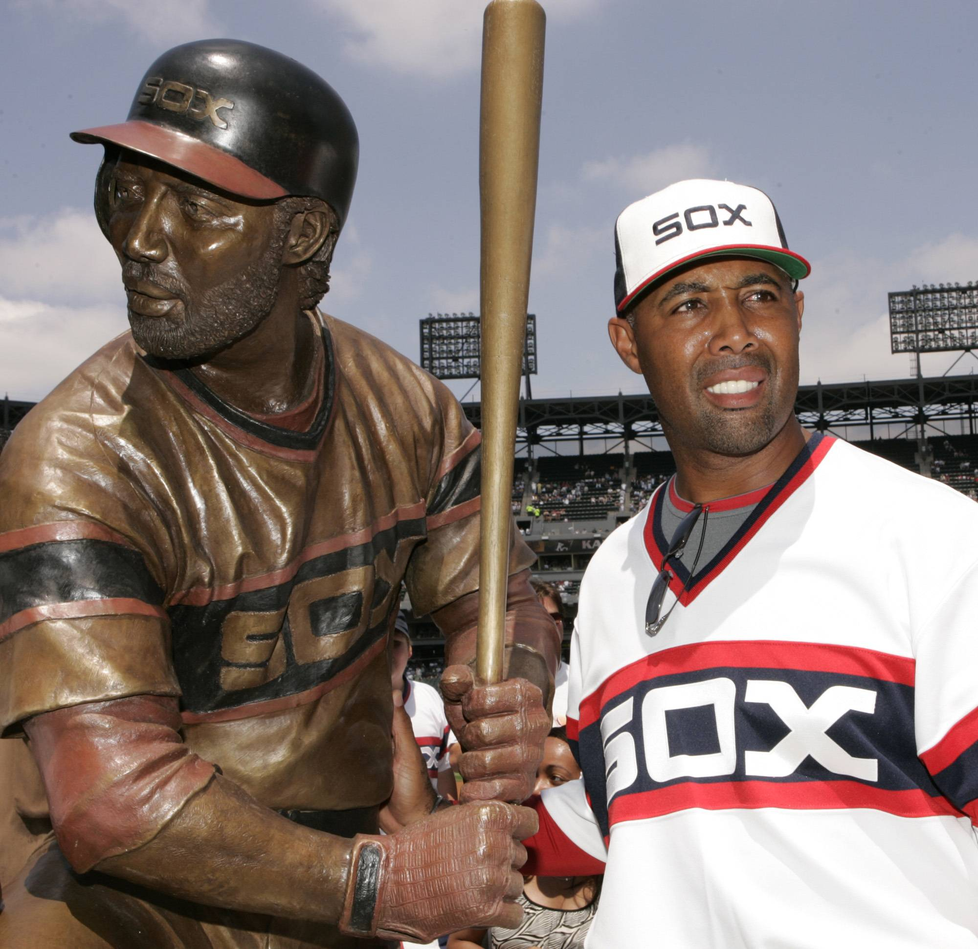 Chicago White Sox first base coach Harold Baines poses with his life-size sculpture during a ceremony before a game in Chicago in 2008.