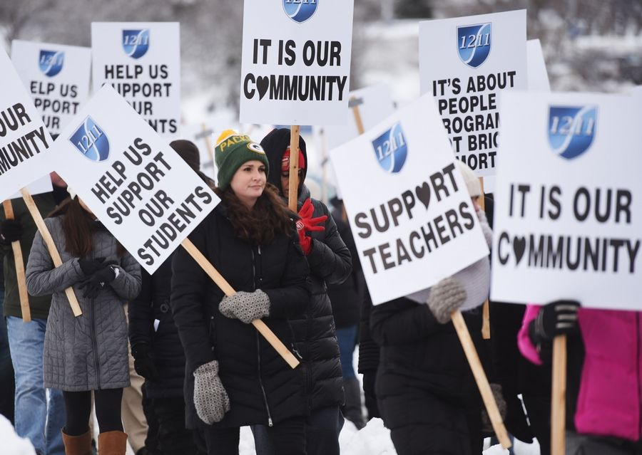 Palatine-Schaumburg High School District 211 teachers picket for a new contract Nov. 27 outside the district's administation building in Palatine.