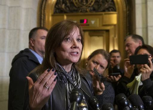 General Motors CEO Mary Barra speaks to reporters after a meeting with Sen. Sherrod Brown, D-Ohio, and Sen. Rob Portman, R-Ohio, to discuss GM's announcement it would stop making the Chevy Cruze at its Lordstown, Ohio, plant, part of a massive restructuring for the Detroit-based automaker, on Capitol Hill in Washington, Wednesday, Dec. 5, 2018. General Motors is fighting to retain a valuable tax credit for electric vehicles as the nation's largest automaker grapples with the political fallout triggered by its plans to shutter several U.S. factories and shed thousands of workers. (AP Photo/J. Scott Applewhite)