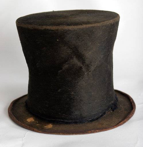 FILE - This June 14, 2007, file photo, shows Abraham Lincoln's iconic stovepipe hat at the Abraham Lincoln Presidential Library and Museum in Springfield, Ill. Media personality and political commentator Glenn Beck is pitching in to keep a trove of artifacts related to Lincoln in the 16th president's hometown. Beck's charity called Mercury One has donated $50,000 toward a $9.2 million debt owed for a collection of 1,400 artifacts purchased a decade ago for the museum. It includes valuable personal effects of Lincoln's and the stovepipe hat whose link to Lincoln has been questioned. (AP Photo/Seth Perlman, File)