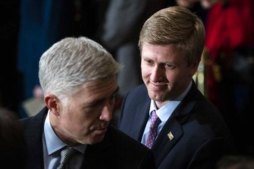 FILE - In a Monday, Dec. 3, 2018 file photo, Nick Ayers, right, listens as Supreme Court Associate Justice Neil Gorsuch waits for the arrival of the casket for former President George H.W. Bush to lie in State at the Capitol on Capitol Hill in Washington. President Donald Trump's top pick to replace John Kelly as chief of staff, Nick Ayers, is no longer expected to fill that role, according to a White House official. The official says that Trump and Ayers could not agree on Ayers' length of service. (Jabin Botsford/The Washington Post via AP, Pool, File)