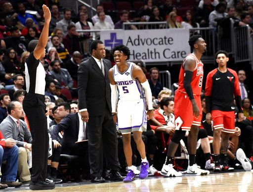 Sacramento Kings guard De'Aaron Fox (5) reacts after making a three-point basket against the Chicago Bulls during the second half of an NBA basketball game Monday, Dec. 10, 2018, in Chicago.
